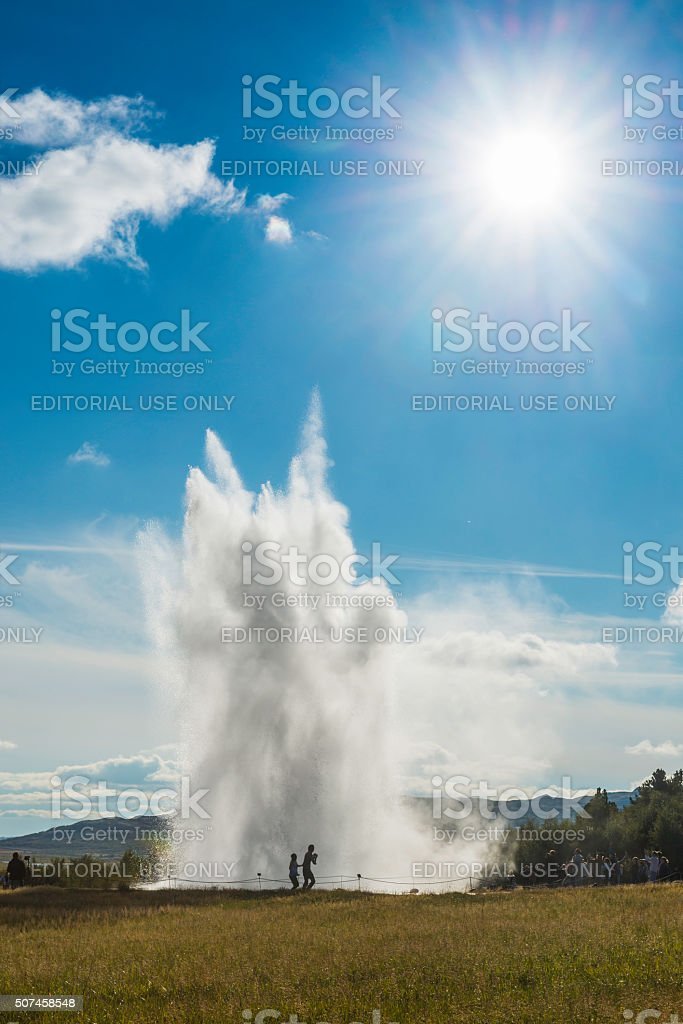 Iceland tourists watching Strokkur geyser erupt steam Golden Circle Reykjavik stock photo