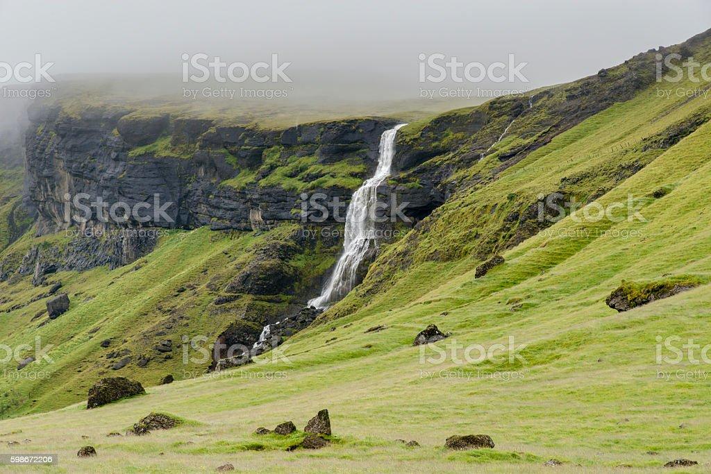 Icelandic foggy landscape. Waterfall. Iceland.