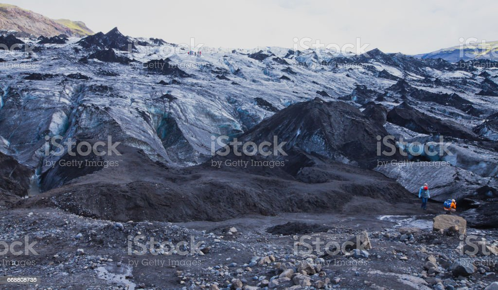Icelandic Glacier with a group of hikers hiking tourists climbing exploring the famous glacier in Iceland stock photo