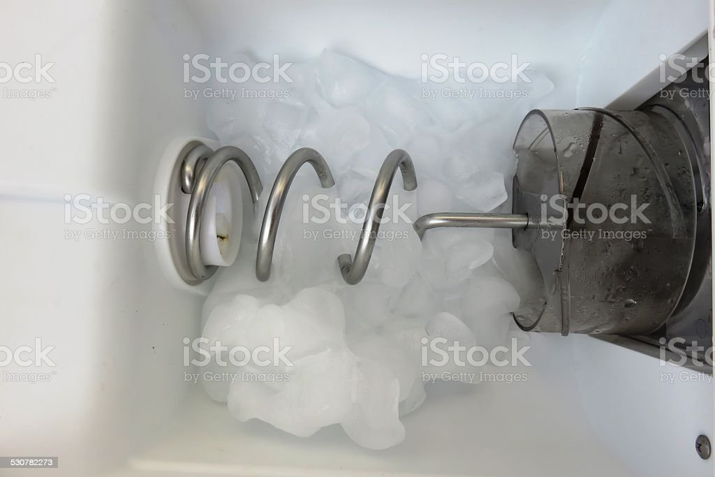 Icemaker in action stock photo
