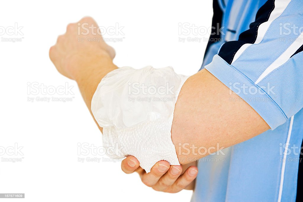 Ice-pack on aching elbow stock photo