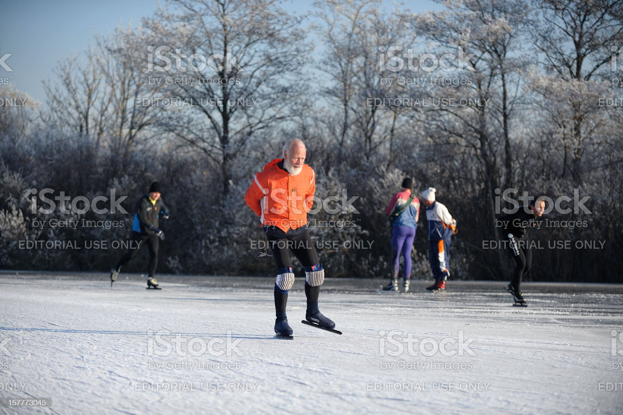 Ice-skating senior on a lake in the Netherlands royalty-free stock photo