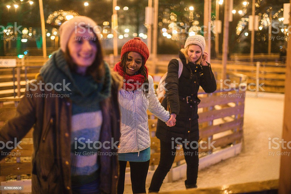 Ice-skating with friends stock photo