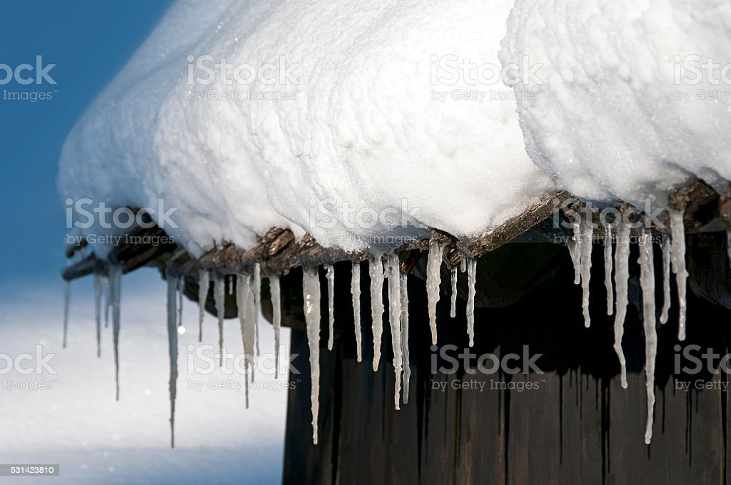 Icicle on hut stock photo
