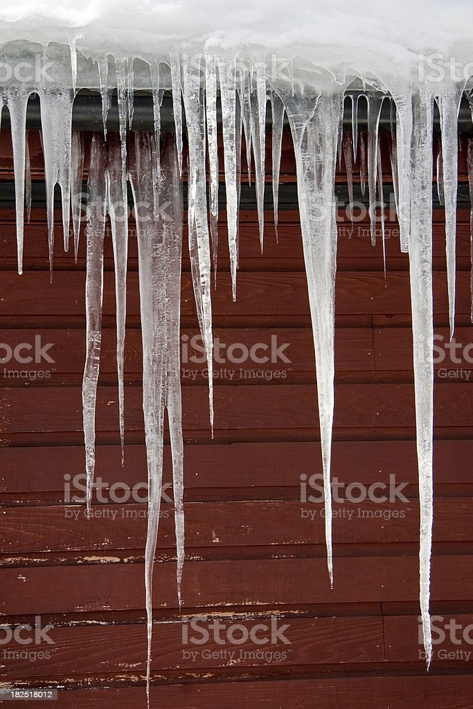 Icicles against a Dark Red Background royalty-free stock photo