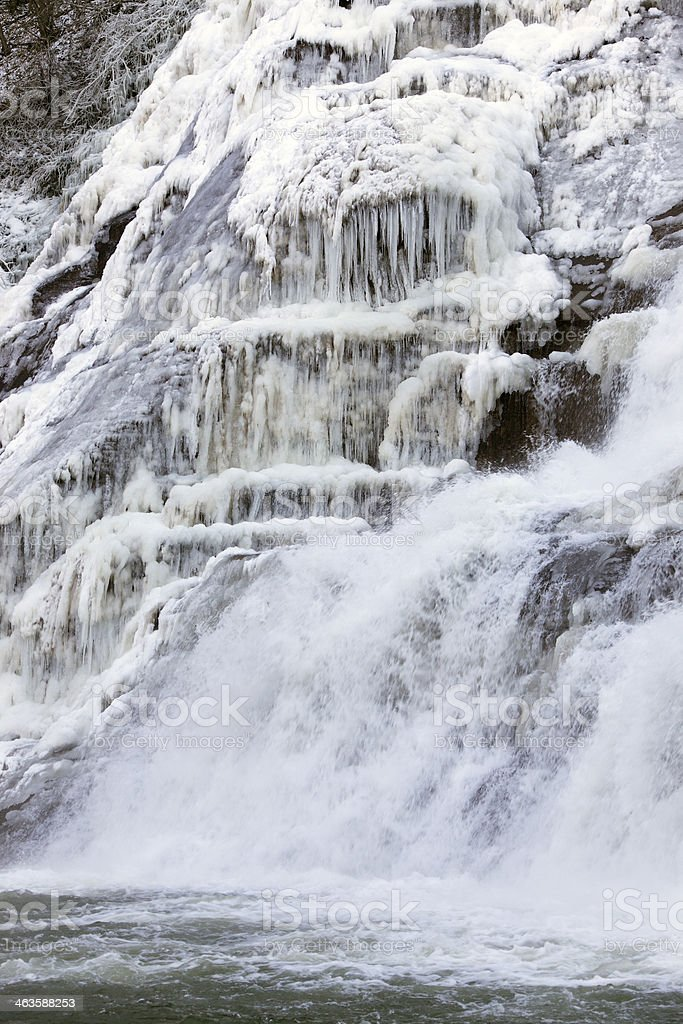 Icicles and snow in frozen waterfall stock photo