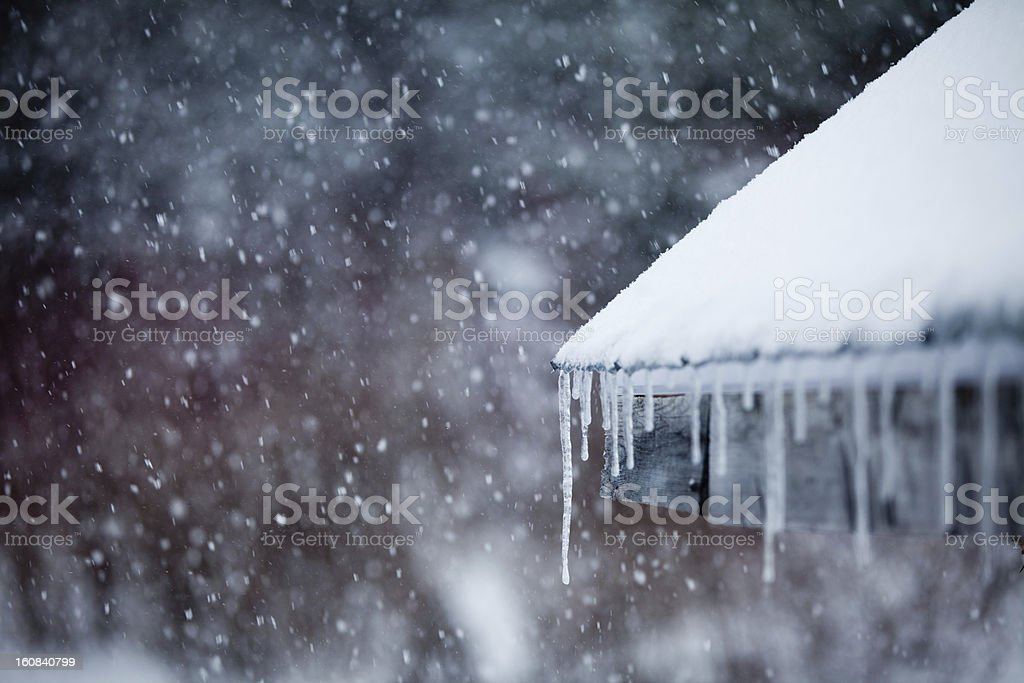 Icicles and Snowstorm stock photo