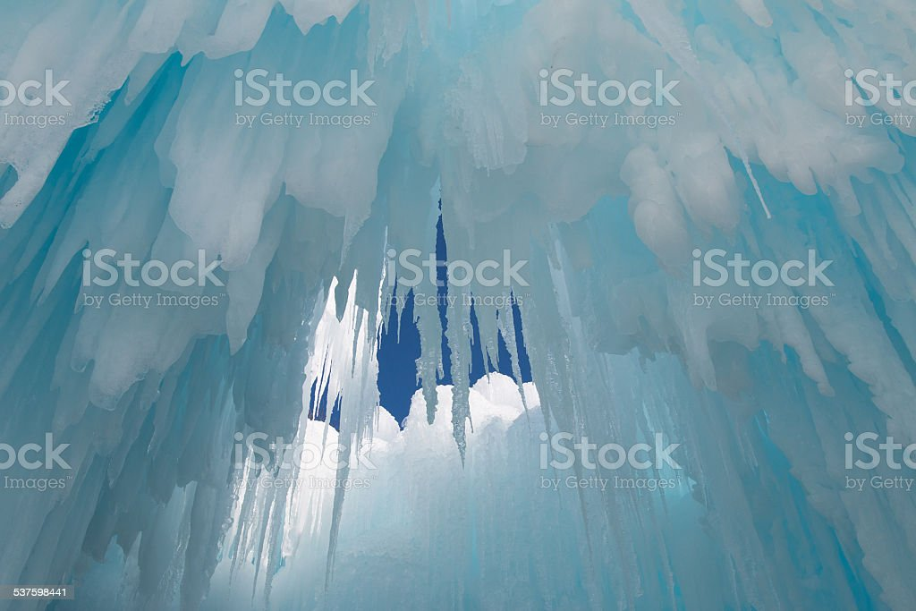 Icicles hang from the ceiling of an ice cave stock photo