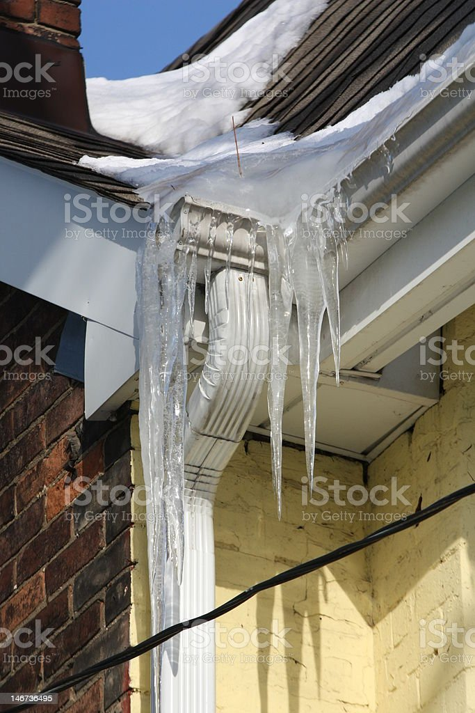 Icicles hanging from eaves royalty-free stock photo