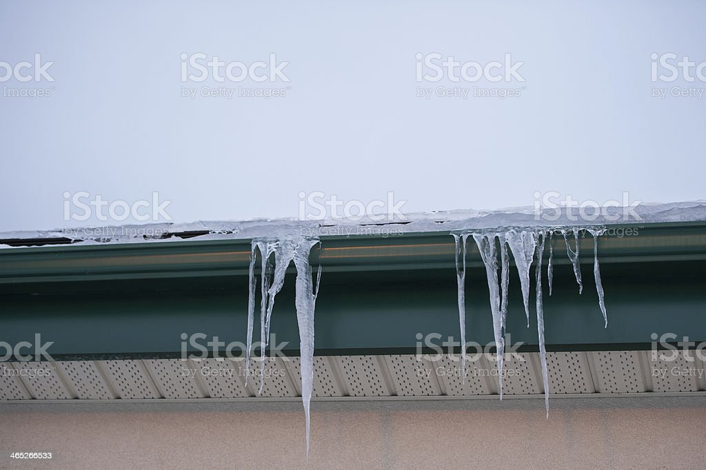 Icicles hanging from roof stock photo