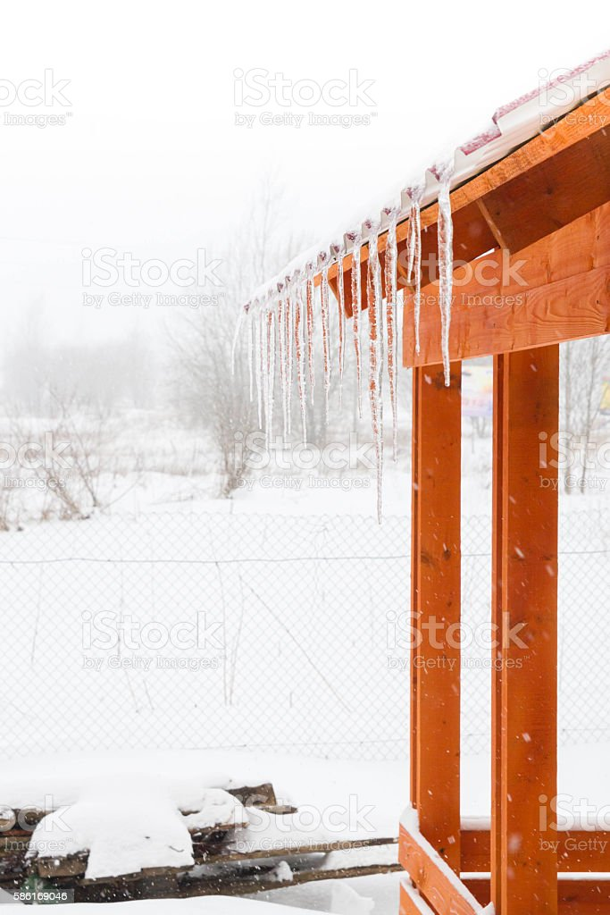 Icicles hanging from the roof of the gazebo stock photo