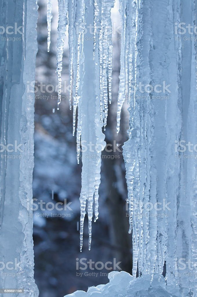 Icicles in a blue ice cave stock photo
