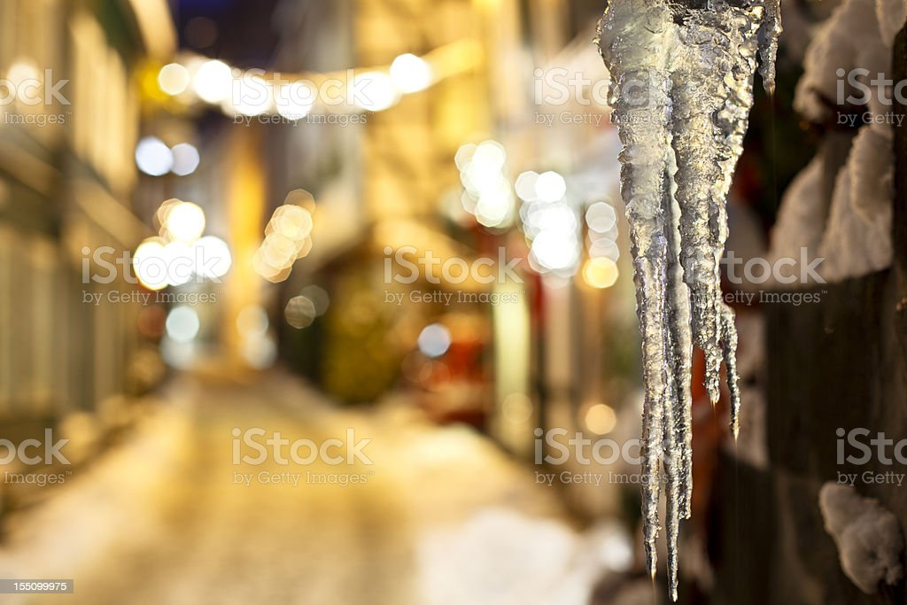 Icicles In A Christmassy Street At Night stock photo