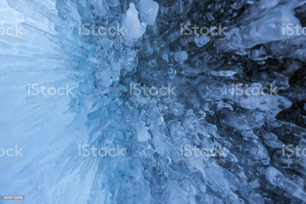 Icicles in the rocky caves at Lake Baikal, Russia stock photo