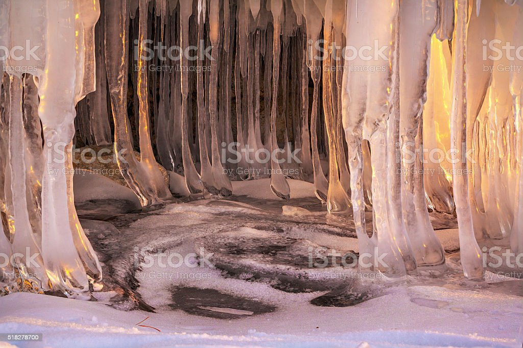 Icicles on frozen Baikal lake. stock photo