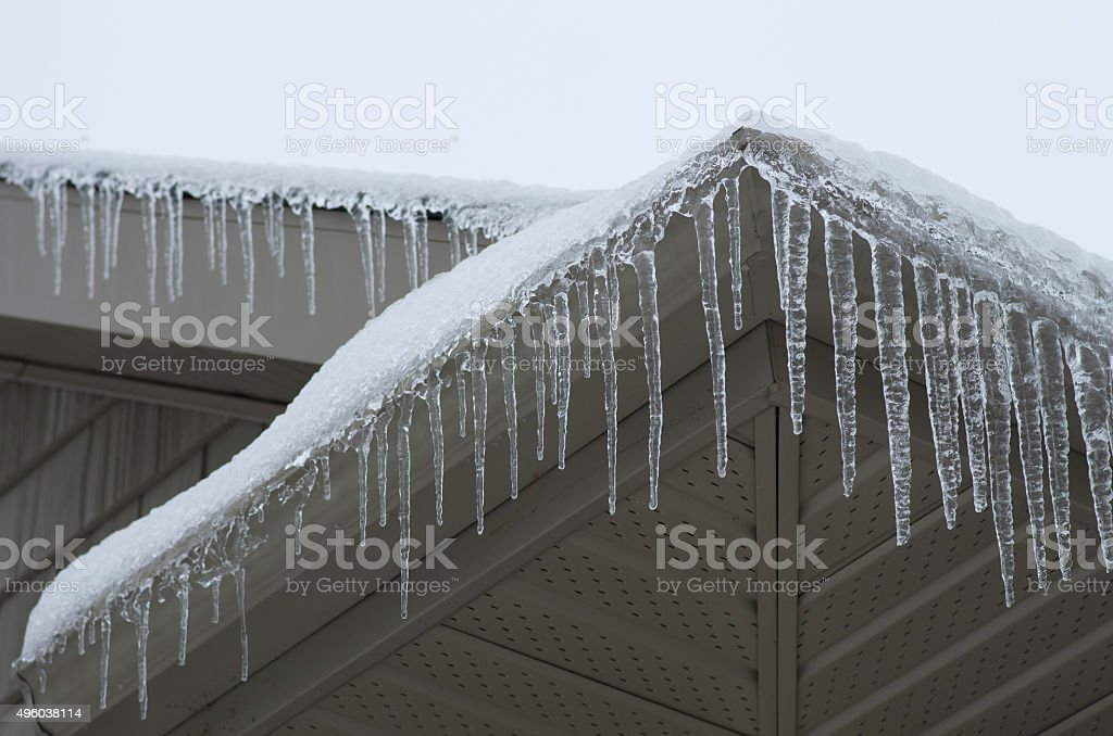 Icicles on House stock photo