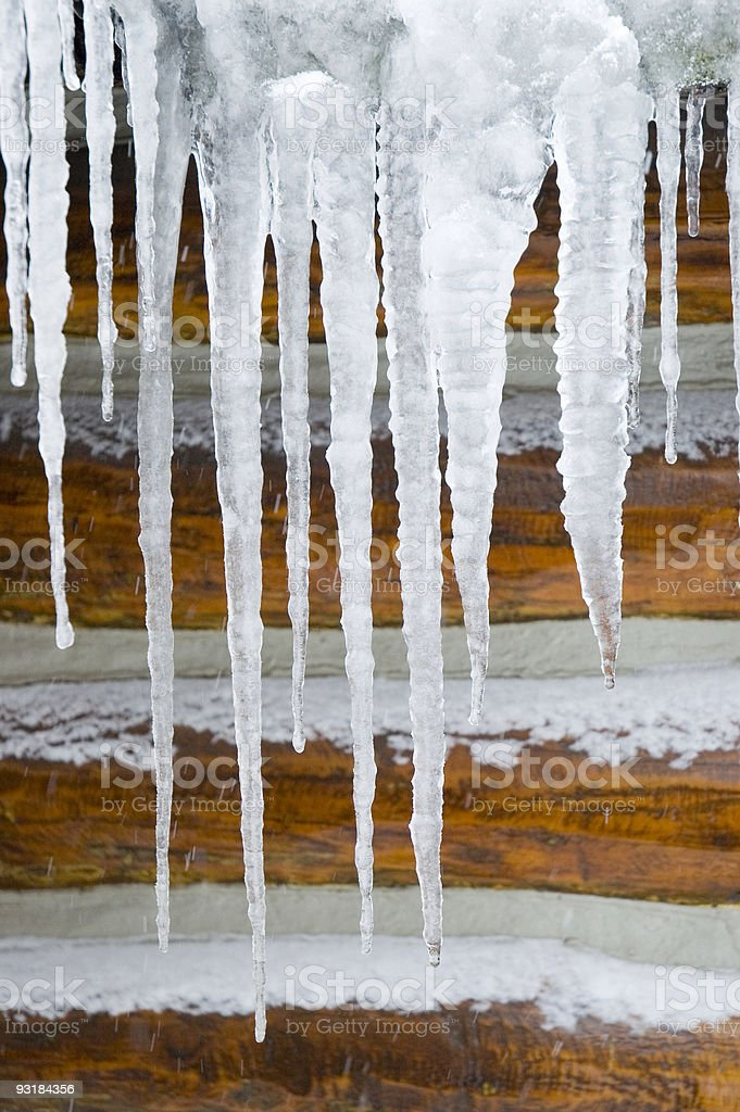 Icicles on Log Background royalty-free stock photo