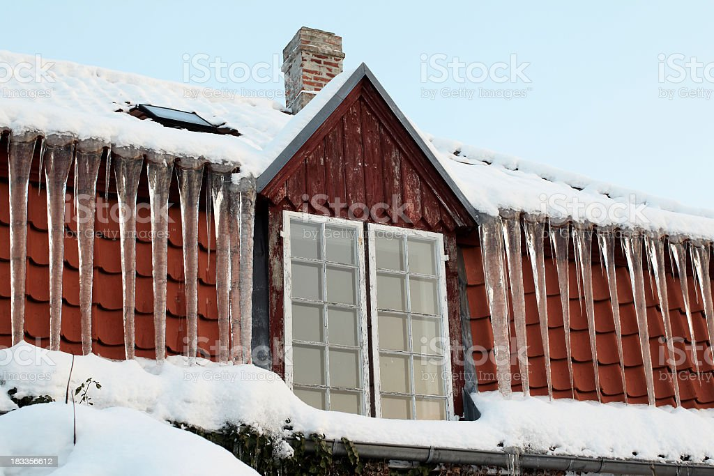 Icicles on roof royalty-free stock photo