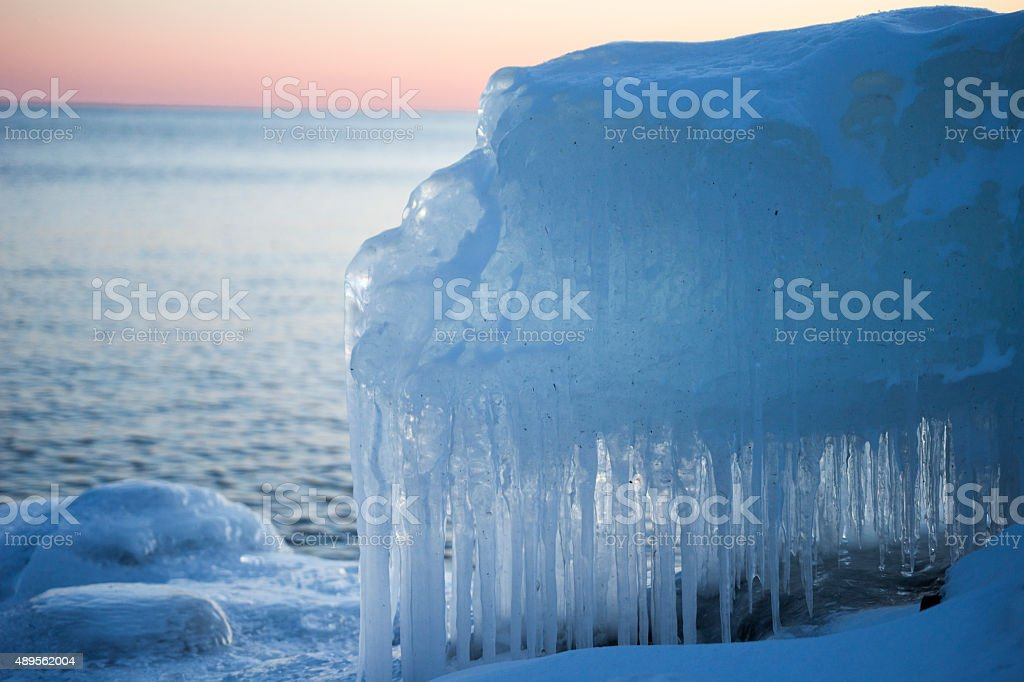 Icicles on snowbank of Lake Superior in winter stock photo