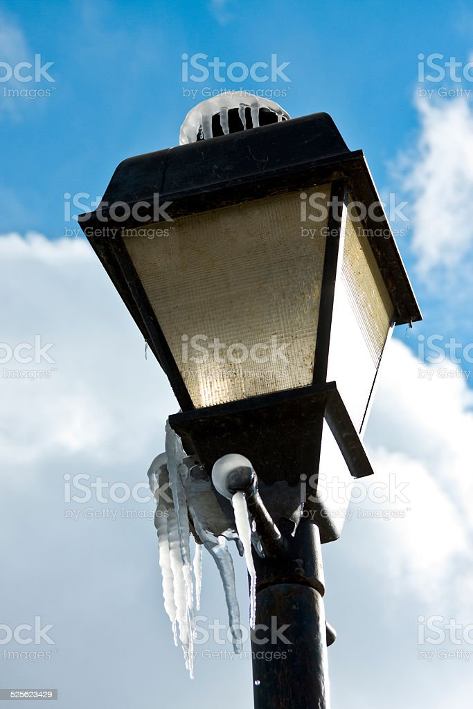 Icicles on Streetlight stock photo