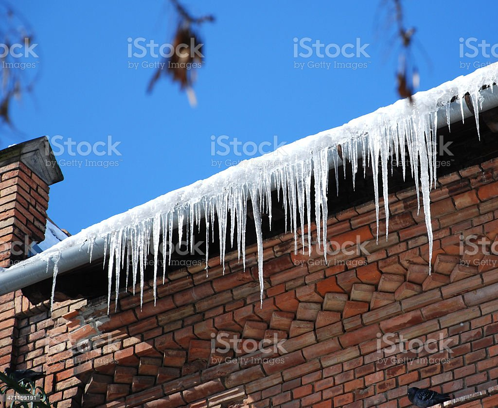 icicles on the eaves royalty-free stock photo