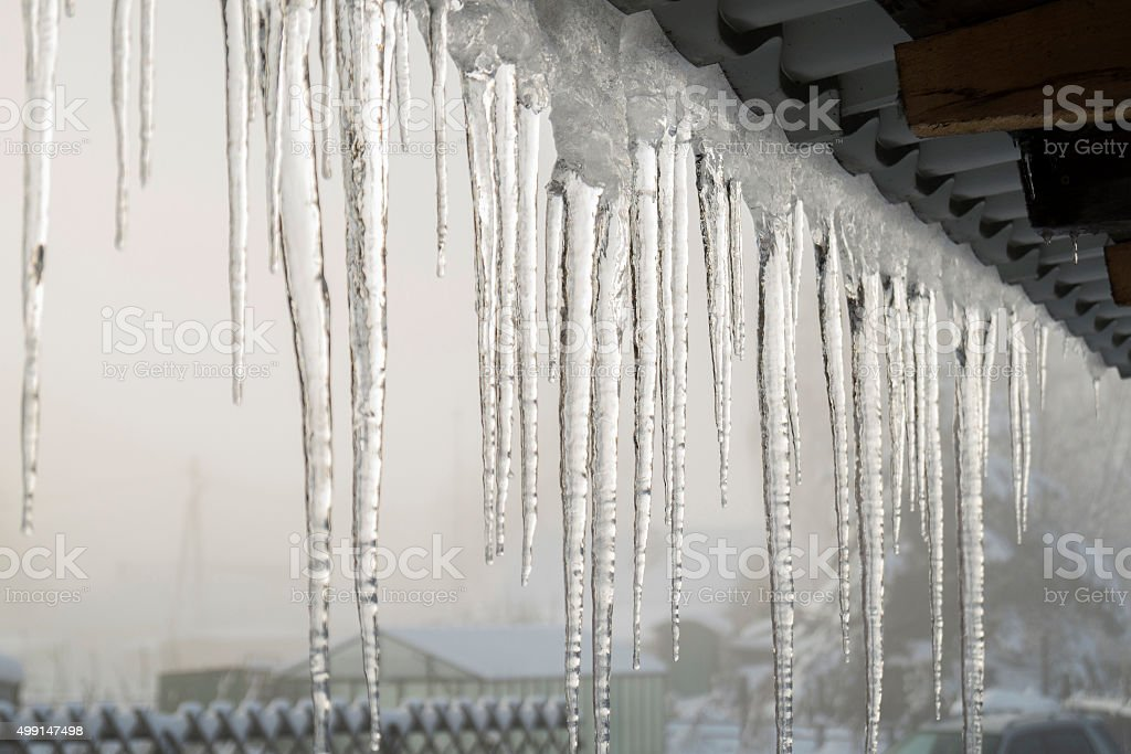 icicles on the eaves stock photo