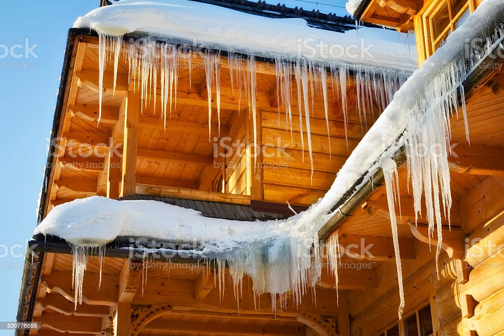 Icicles on the holiday cottage stock photo