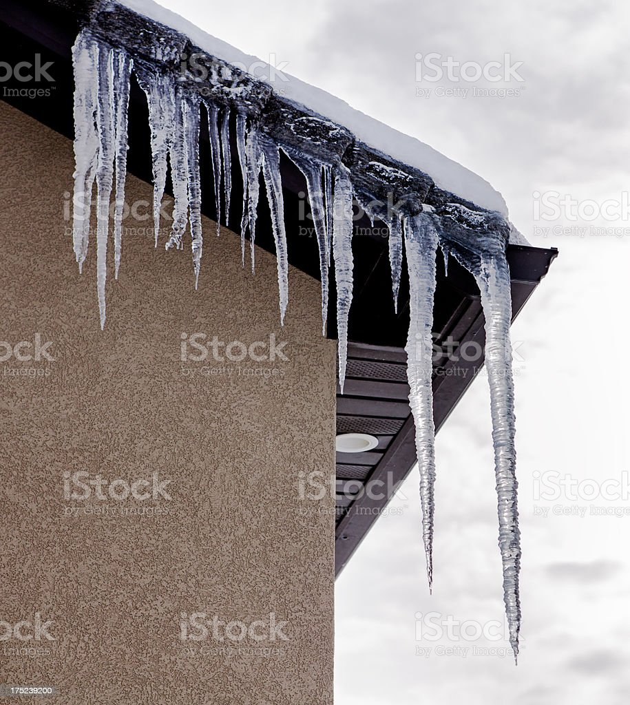 Icicles On The Side Of A House royalty-free stock photo