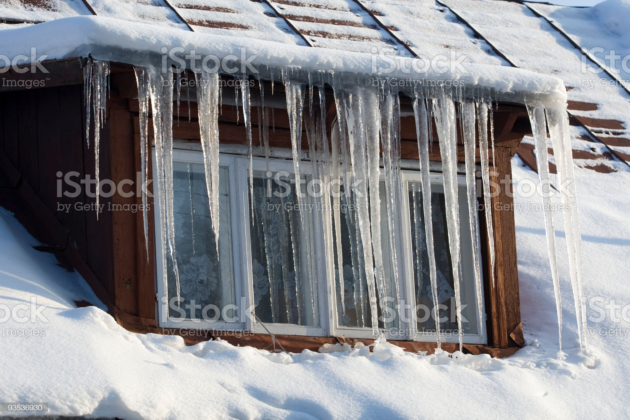 Icicles on wooden window royalty-free stock photo