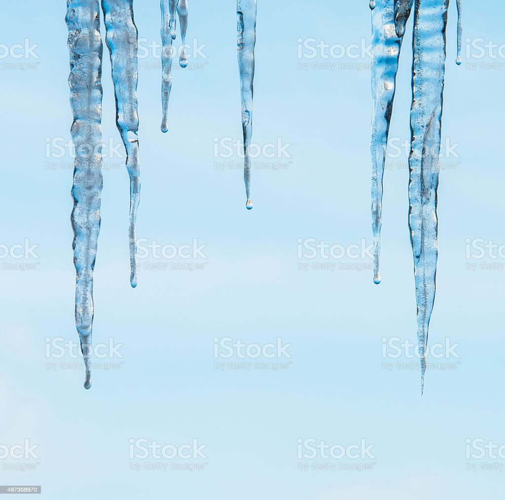 icicles sparkling white with water drops stock photo