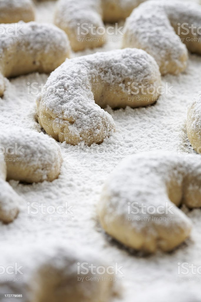 Icing coated crescent biscuit stock photo