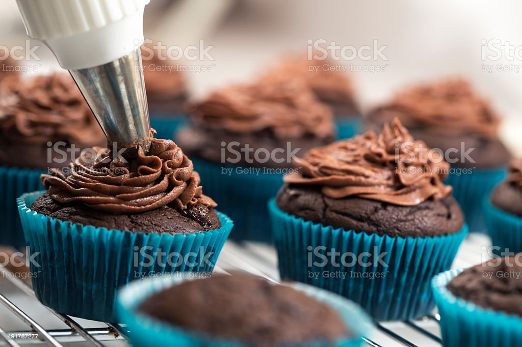 Icing Cupcakes stock photo