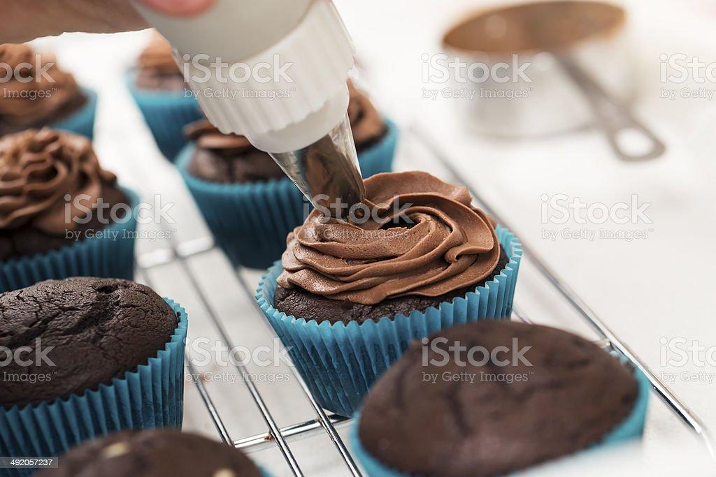 Icing Cupcakes stock photo