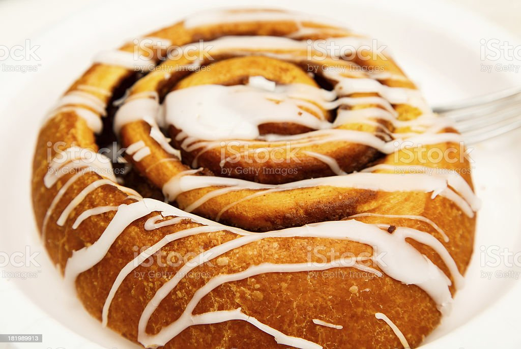 Icing on Cinnamon Roll royalty-free stock photo