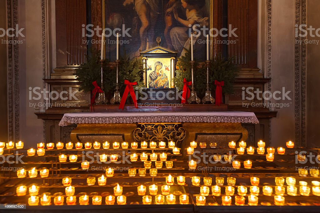 Icon and candles in cathedral at Salzburg Austria stock photo