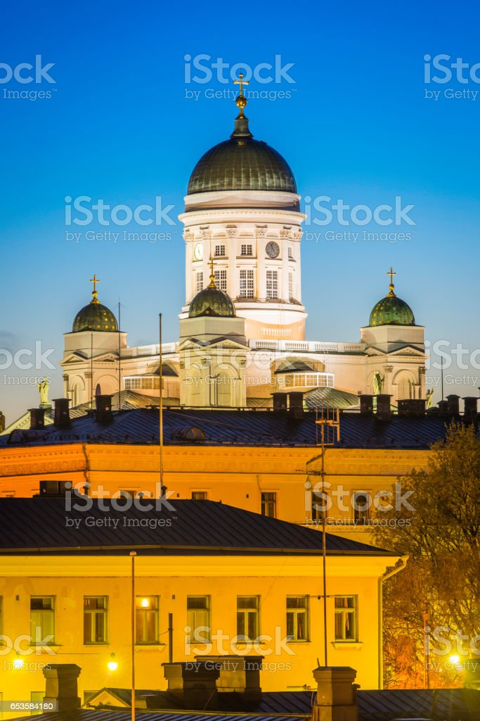 Iconic domes of Helsinki Cathedral towering overlooking government buildings Finland stock photo