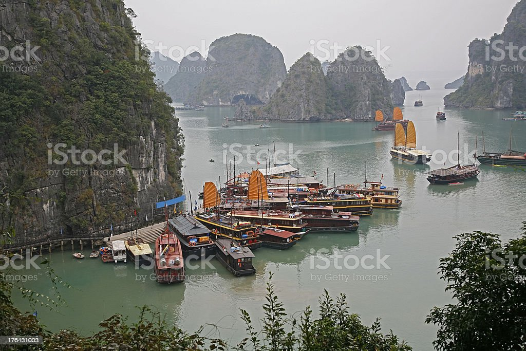 Iconic Halong Bay scene with sails and islands royalty-free stock photo
