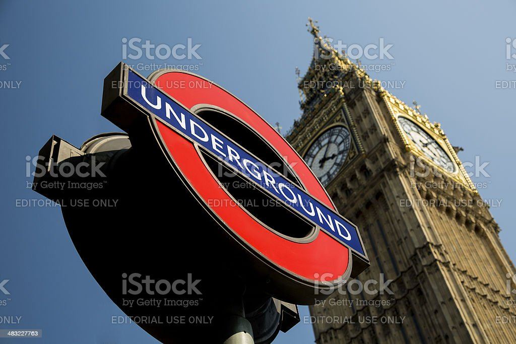 Iconic London underground sign in front of Big Ben stock photo