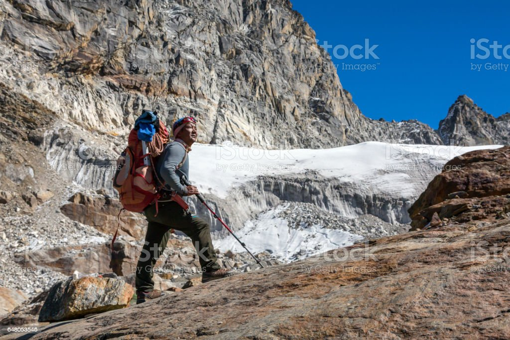 Iconic Portrait of Nepalese Mountain Guide staying and looking up stock photo