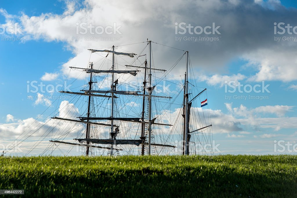 Iconic ship behind dike in Holland stock photo