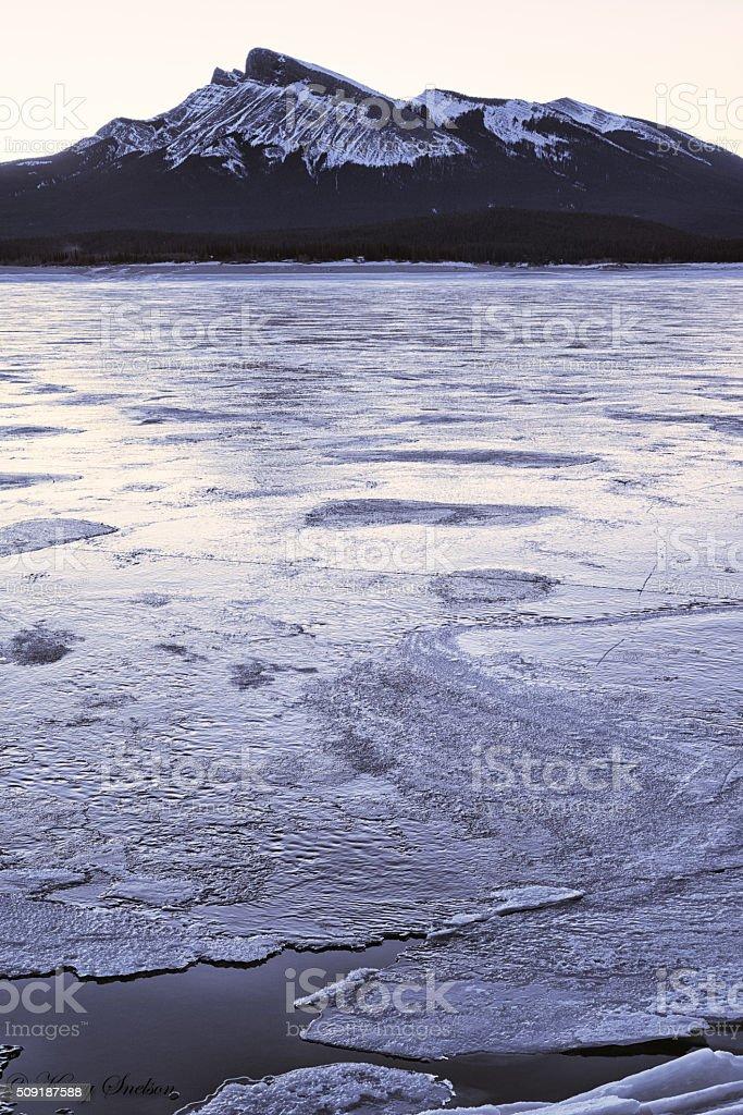 Icy Abraham Lake and Kista Peak stock photo