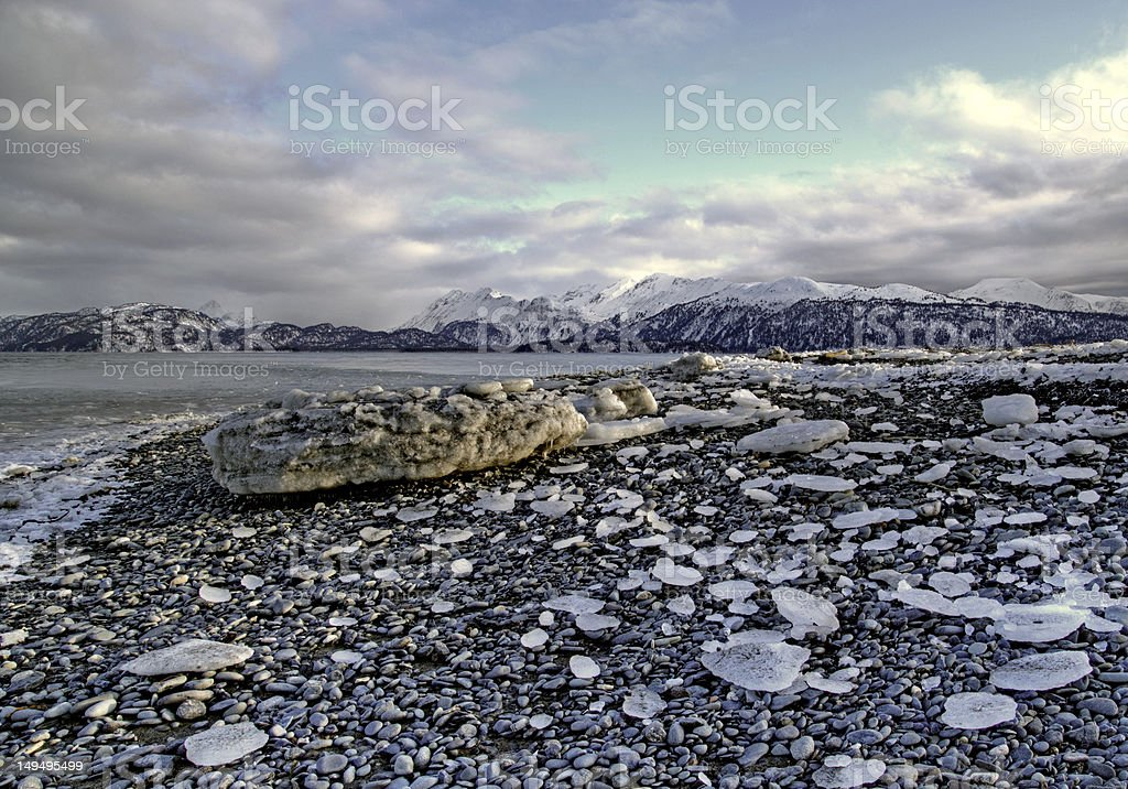 Icy beach with clouds stock photo