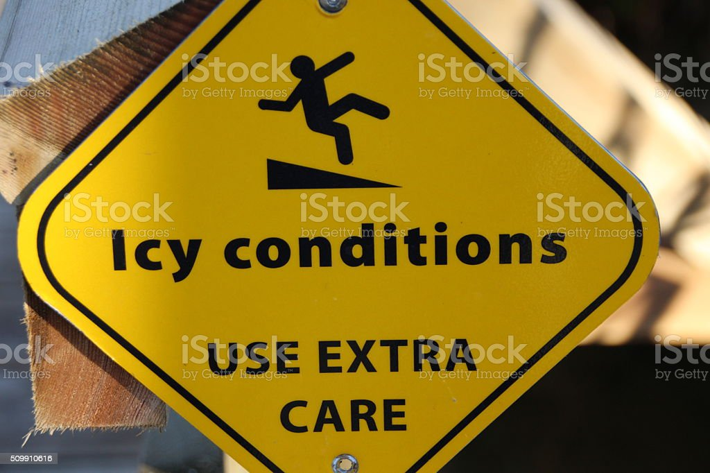 Icy conditions warning sign stock photo