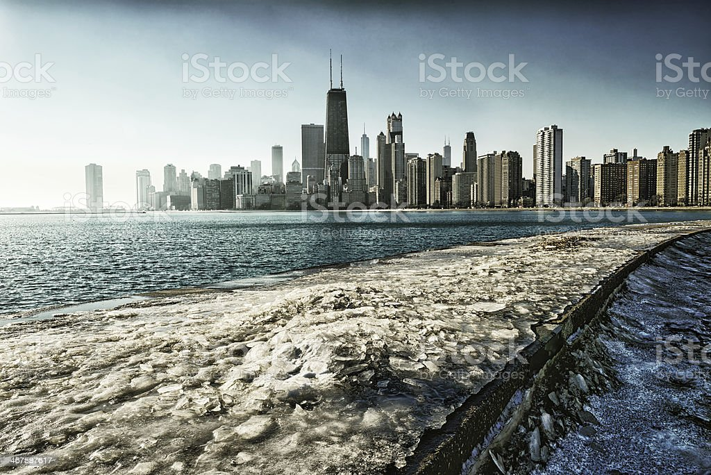 Icy fishing pier on  Lake Michigan and Chicago skyline stock photo