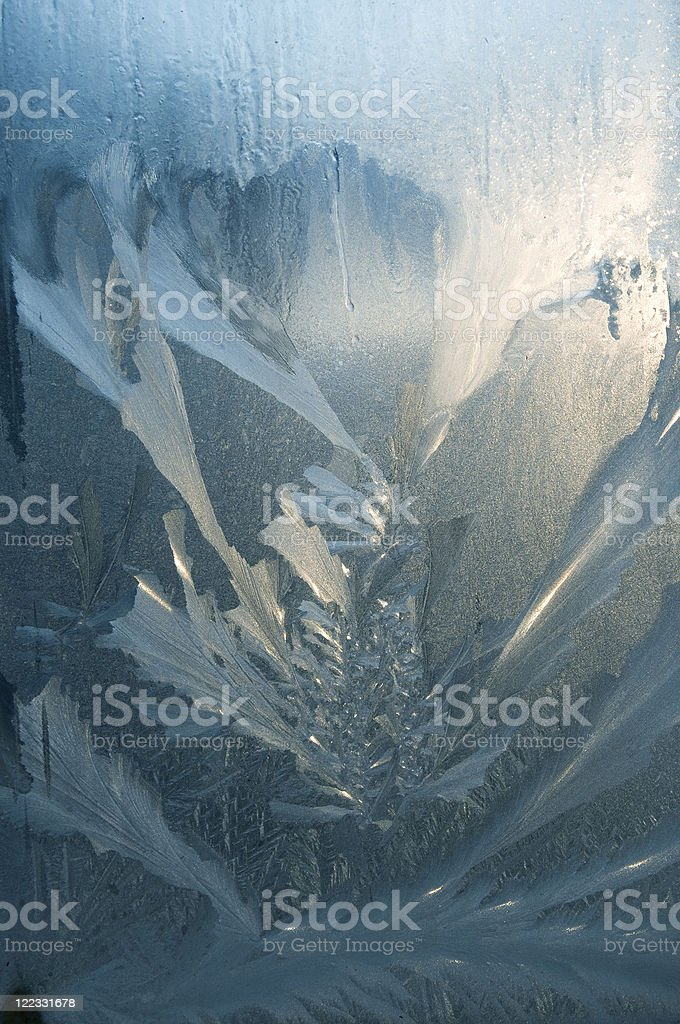 Icy pattern on glass stock photo