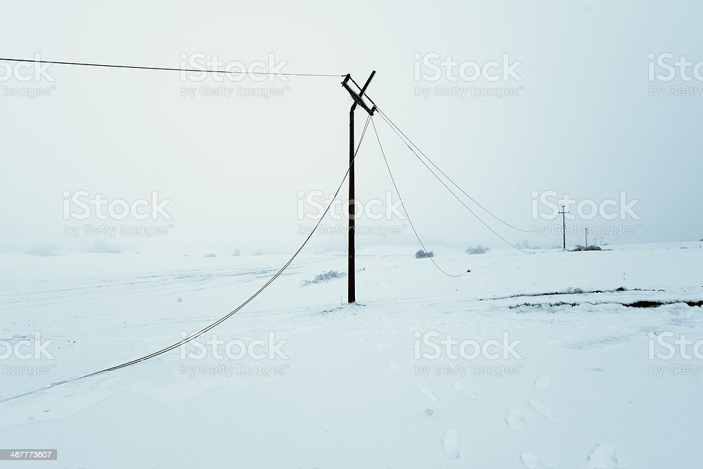 Icy Power Poles Falling stock photo