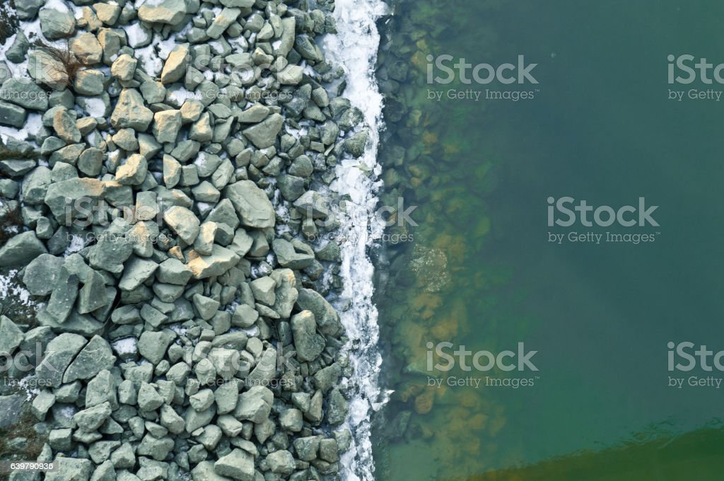 Icy river bank aerial view stock photo