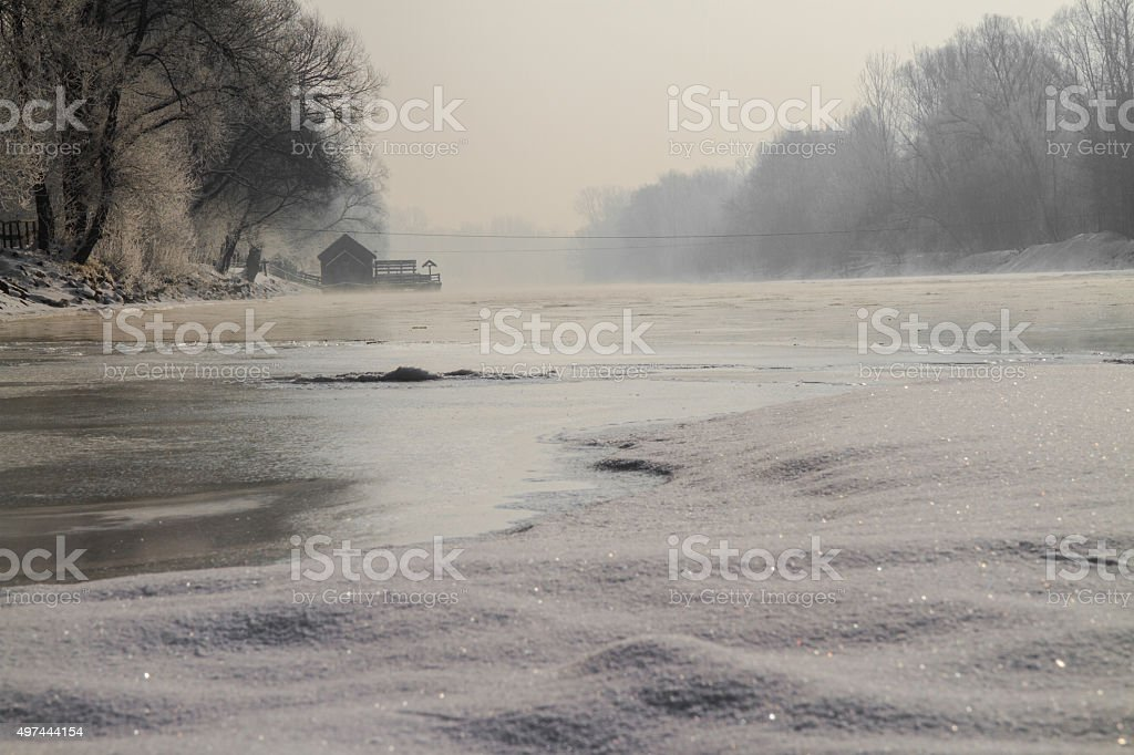 Icy river with watermill stock photo