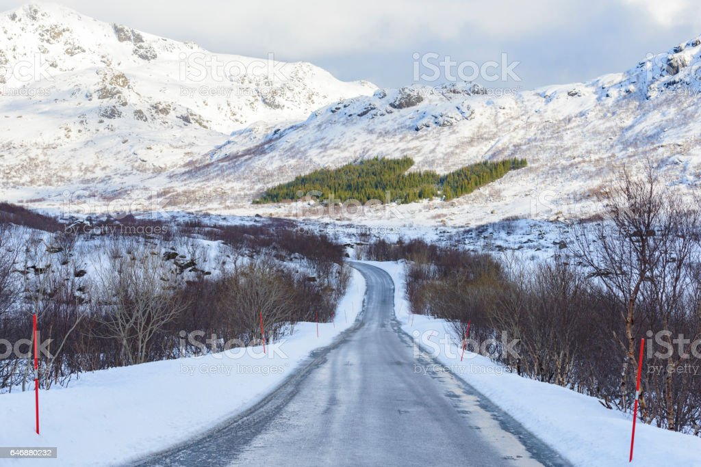 Icy road through the mountains in winter stock photo