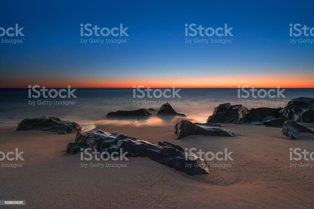 Icy rock seascape stock photo